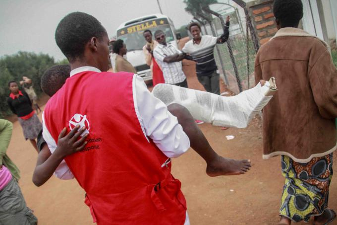 A boy with a broken leg is transported to hospital via Save the Children's ambulance service
