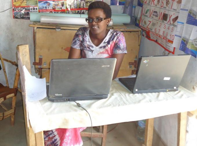 Christine has invested the money to grow her computer training center.