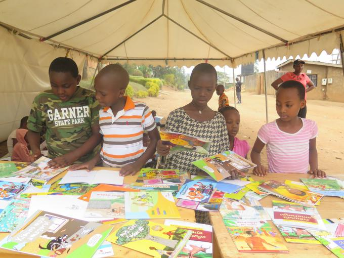 Some of the children picking out more books of their choice at the literacy Umuganda event