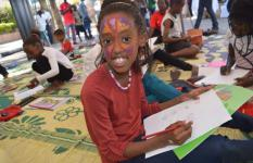 One of the children happily participating in the activities of the Chocolate Book Campaign
